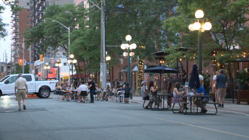Customers dine at outdoor patios expanded onto Somerset St. W. in Ottawa July 3, 2020. (Taylor Rossi / CTV News Ottawa)