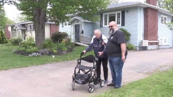 Ralph Richardson and his caretaker walk laps in the driveway of his Riverview, N.B. home to raise money for Parkinson's Canada.