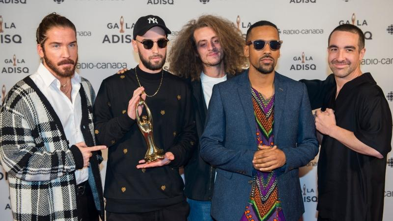 Members of Alaclair Ensemble hold up their award at the Gala Adisq awards ceremony in Montreal, Sunday, October 27, 2019.THE CANADIAN PRESS/Graham Hughes