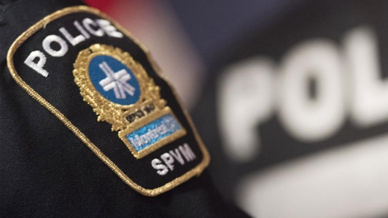 A Montreal Police badge is shown during a news conference in Montreal, Monday, October 7, 2019. Montreal police will unveil its new street checks policy today, months after a damning independent report last year found evidence of systemic bias linked to race is present in who they decide to stop. THE CANADIAN PRESS/Graham Hughes