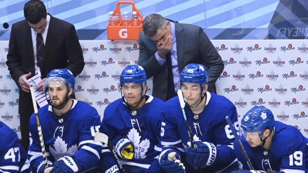 Toronto Maple Leafs head coach Sheldon Keefe, top centre, reacts after his team gives up the second goal of the game to the Columbus Blue Jackets during third period NHL Eastern Conference Stanley Cup playoff action in Toronto on Sunday Aug. 9, 2020.