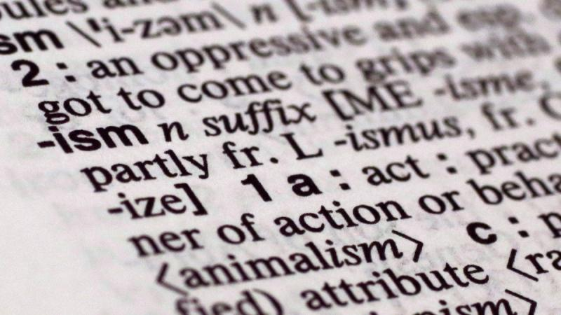 The suffix 'ism' in Merriam-Webster's Collegiate Dictionary. (AP Photo/Richard Drew)