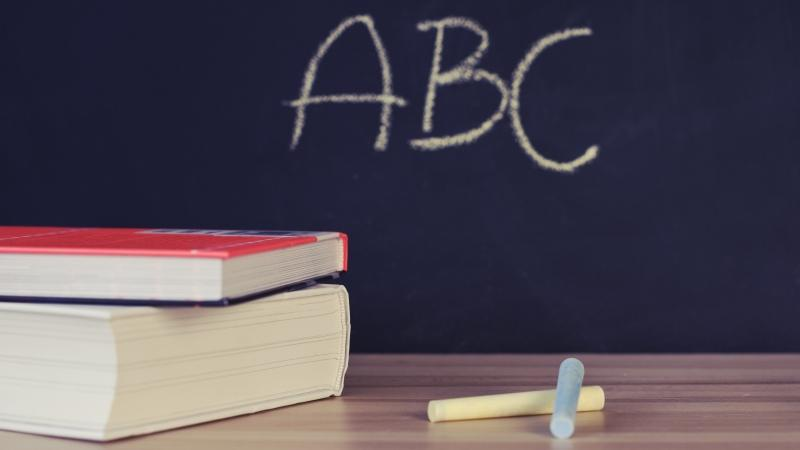 A chalkboard and textbooks are seen in this file photo. (Pexels)