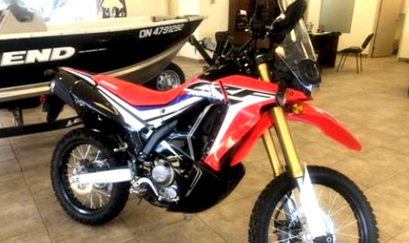The theft took place around 4:20 a.m. when this red 2017 Honda CRF motor was stolen. At the time it was taken from the business, the bike had a licence plate of 2J7M4. (Supplied)
