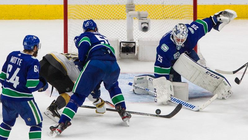 Vancouver Canucks' goalie Jacob Markstrom (25) makes a save against the Vegas Golden Knights during second period NHL Western Conference Stanley Cup playoff action in Edmonton on Sunday, August 30, 2020. THE CANADIAN PRESS/Jason Franson