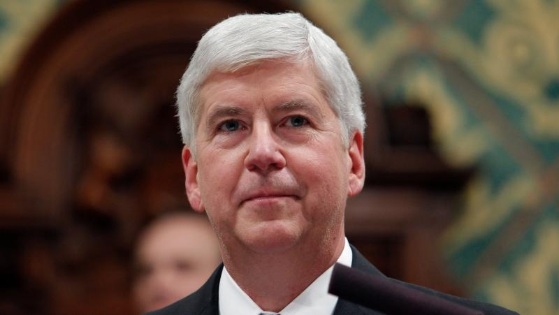 In this Jan. 23, 2018, file photo Michigan Gov. Rick Snyder delivers his State of the State address to a joint session of the House and Senate at the state Capitol in Lansing, Mich. (AP Photo/Al Goldis, File)