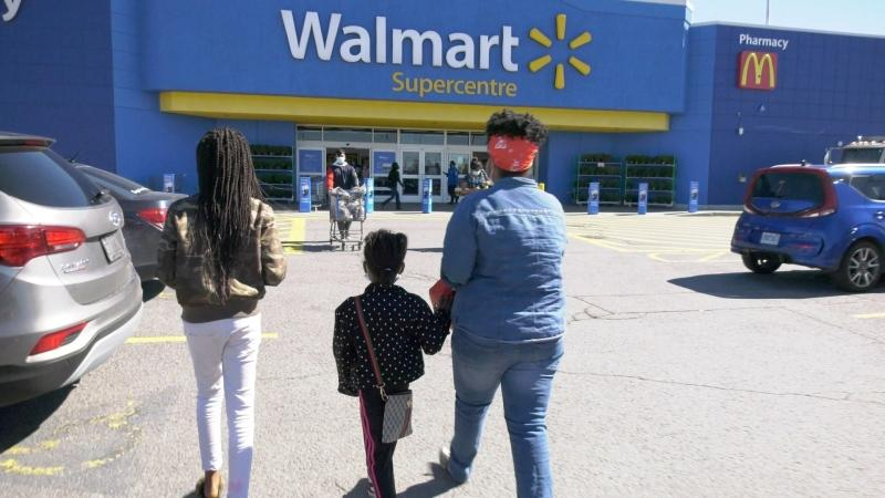 A family heading into Walmart for back to school shopping. (Dave Charbonneau / CTV News Ottawa)