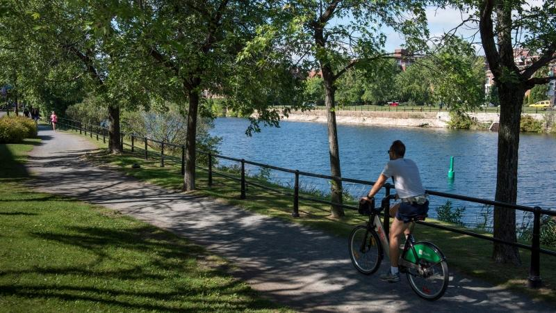 A cyclist ride his bike along the Lachine Canal Wednesday, September 3, 2014 in Montreal. THE CANADIAN PRESS/Paul Chiasson