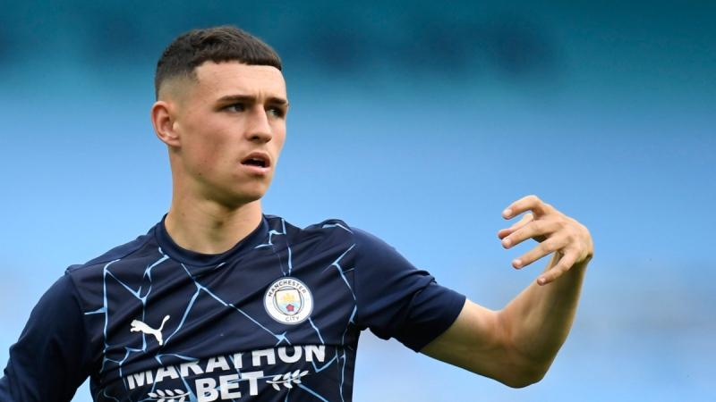 Phil Foden warms up at the Etihad Stadium stadium in Manchester, England, on Aug. 7, 2020. (Peter Powell / Pool Photo via AP)