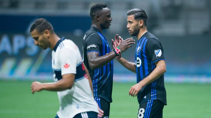 Montreal Impact midfielder Saphir Taider (8) celebrates his goal with teammate Victor Wanyama (2) as Vancouver Whitecaps defender Ali Adnan (53) walks past during the first half of MLS soccer action in Vancouver, B.C. Sunday, September 13, 2020. THE CANADIAN PRESS/Jonathan Hayward