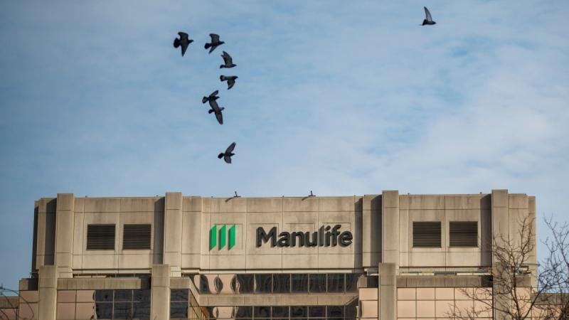 Signage is seen on Manulife Financial Corp.'s office tower in Toronto, on Feb. 11, 2020. (Cole Burston / THE CANADIAN PRESS)