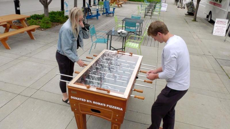 A foosball table has been set up outside Roma's Pizzeria in Bridgeland to be used by the community.