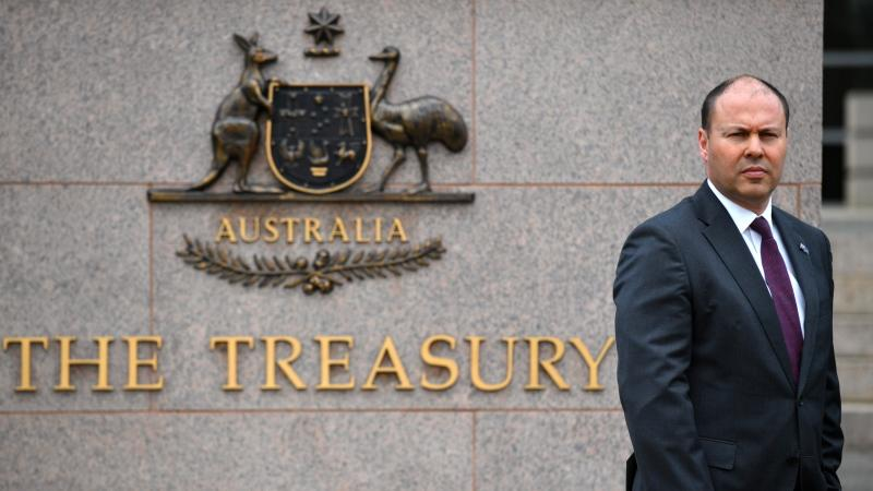 Australia's Treasurer Josh Frydenberg is photographed outside The Treasury in Canberra, Monday, Oct. 5, 2020. (Mick Tsikas/AAP Image via AP)