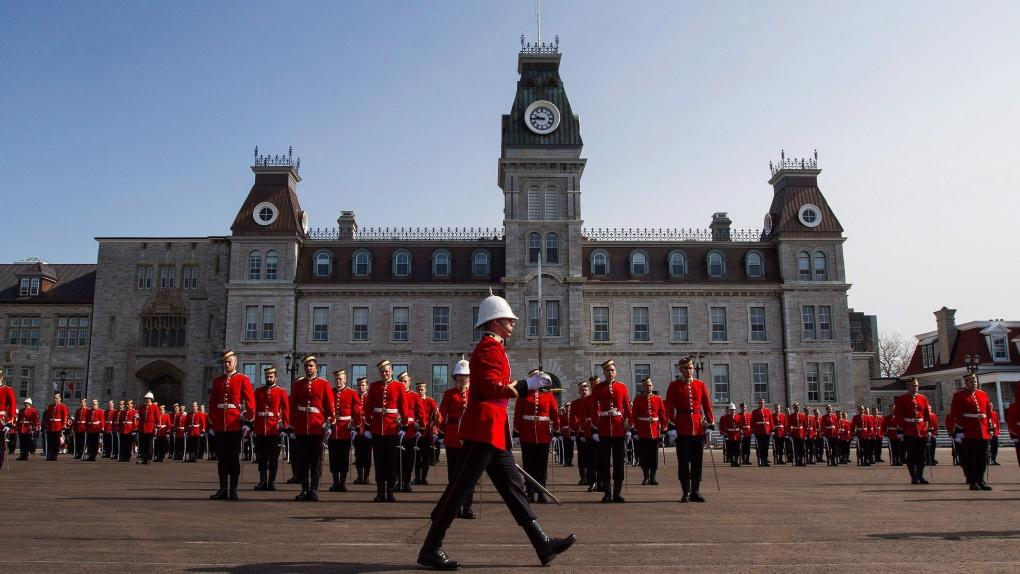 Members of the graduation class of Royal Military College of Canada stand in the square at RMC during graduating ceremony in Kingston on Friday, May 20, 2016. (THE CANADIAN PRESS/Lars Hagberg)