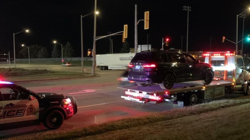 An SUV on the back of a tow truck after a driver was allegedly stopped for stunt driving. (@WRPS_Traffic)