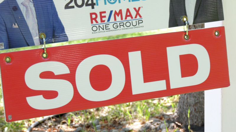 A house with a sold sign in Winnipeg is pictured on August 11, 2020 (CTV News Photo Scott Andersson0