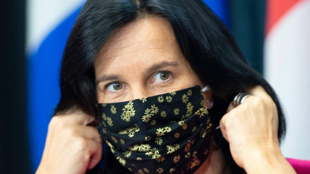 Montreal Mayor Valérie Plante removes her face mask as she arrives at a news conference, Friday, September 18, 2020 in Montreal.THE CANADIAN PRESS-Ryan Remiorz