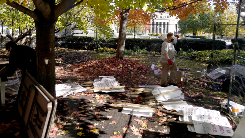 Crews clear out detritus after an encampment set up by a fringe protest group beside the National War Memorial was removed, on Saturday, Oct. 17, 2020, after it was vandalized earlier in the day. (Justin Tang/THE CANADIAN PRESS)