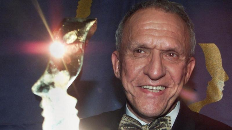 Jacques Godin holds his trophy for his lead role in Sous le signe du lion at the Gemeaux Gala Sunday, Sept. 30, 2001 in Montreal. Godin passed away at the age of 90 on Oct. 26, 2020. (CP PHOTO/Paul Chiasson)