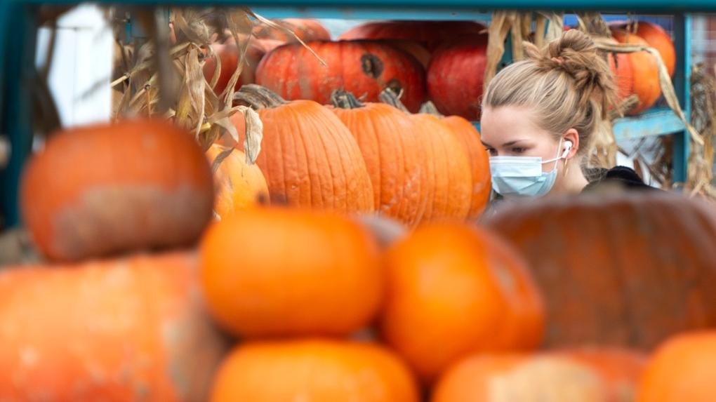 A woman shops for pumpkins at a market, Wednesday, October 28, 2020 in Montreal.THE CANADIAN PRESS-Ryan Remiorz