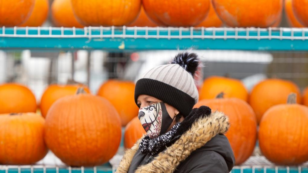 A pumpkin vendor waits for customers at a market, Wednesday, October 28, 2020 in Montreal.THE CANADIAN PRESS-Ryan Remiorz