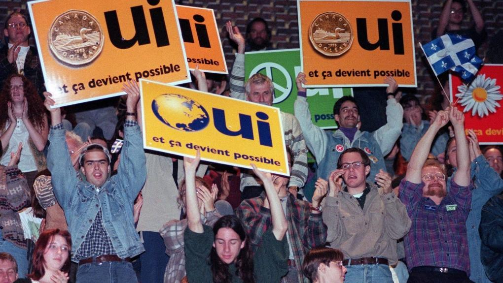 Yes supporters cheer during a speech by Bloc Quebecois Leader Lucien Bouchard at a junior college in Montreal Tuesday, Oct. 24, 1995. (Ryan Remiorz  THE CANADIAN PRESS)