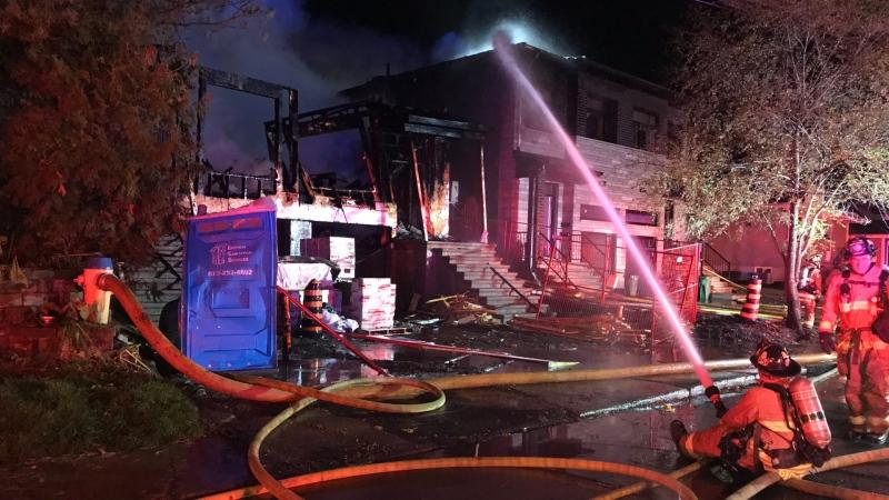 Firefighters battle a blaze on Longpré Street in Vanier, Oct. 31, 2020. The fire, which started in a home under construction, spread to the attic of two neighbouring homes, displacing the residents there. (Photo provided by Ottawa Fire Services)