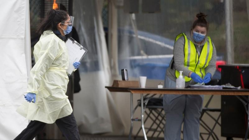 A health care worker is pictured working at Vancouver's first drive through COVID-19 testing site for health care workers in Vancouver, B.C. Monday, March 23, 2020. THE CANADIAN PRESS/Jonathan Hayward