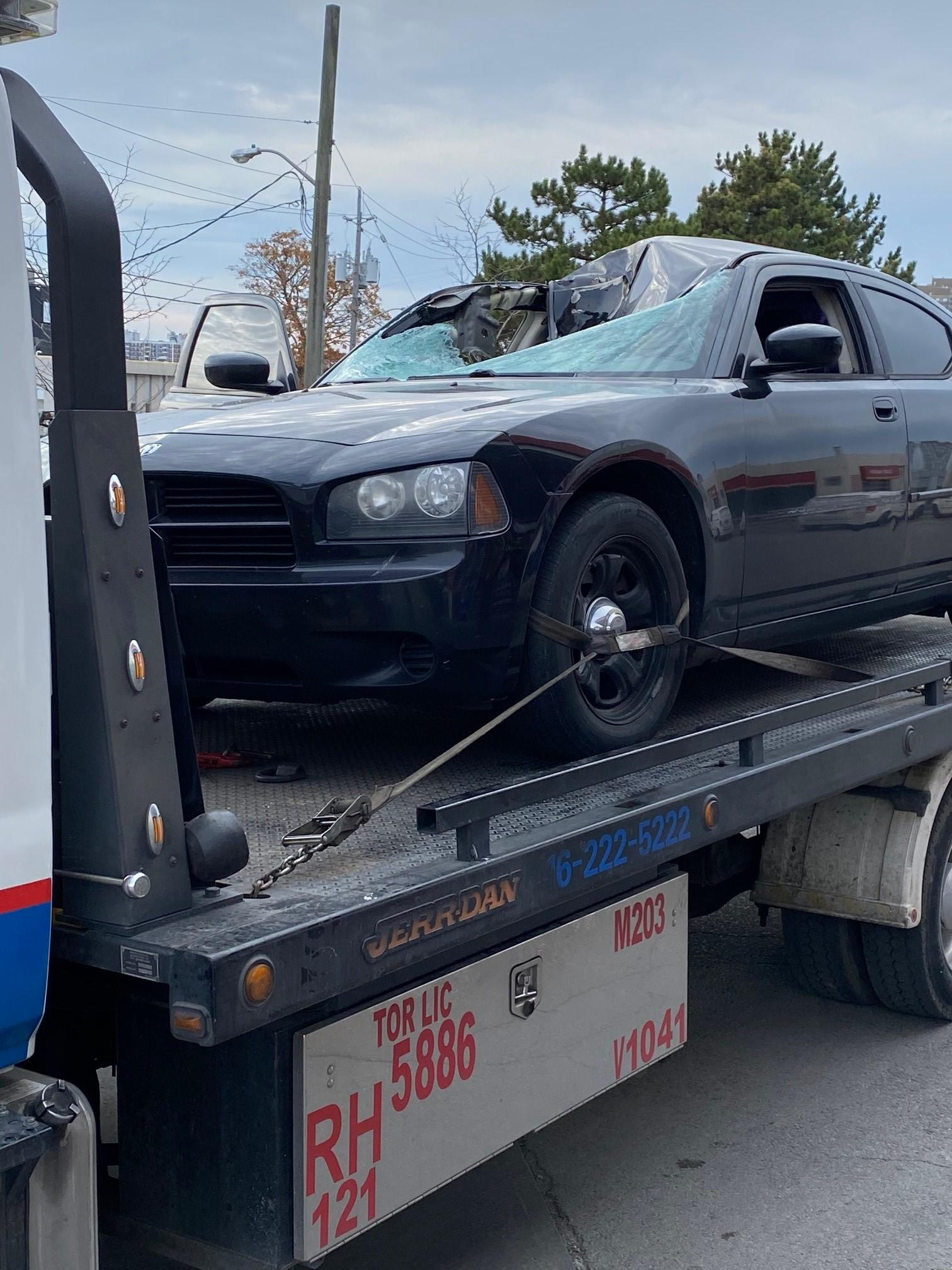 The Dodge Charger struck by a flying tire