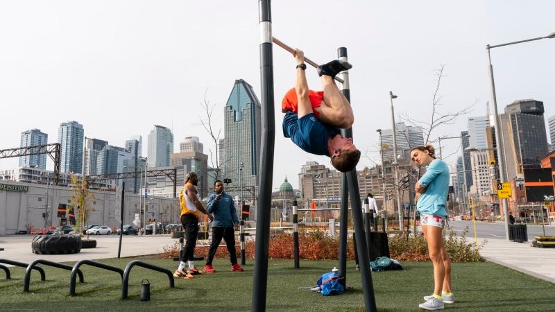 People work out at an outdoor gym in downtown Montreal, on Friday, November 6, 2020. Gyms and fitness centres are closed in the province of Quebec due to COVID-19 restrictions. THE CANADIAN PRESS/Paul Chiasson