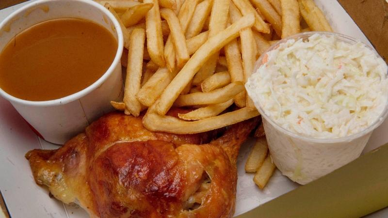 A quarter chicken leg in a take out box from St. Hubert in Montreal on Thursday, March 31, 2016. The Quebec-based chain has agreed to be acquired by the owner of the Swiss Chalet chain for $537 million. THE CANADIAN PRESS/Peter McCabe