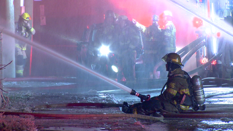 Firefighters in Laval on the scene of a major apartment fire on Wednesday morning / Cosmo Santamaria, CTV News Montreal