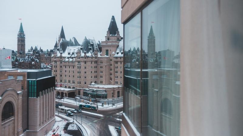 Parliament Hill and the Fairmont Chateau Laurier in Ottawa are seen during the winter in this undated photo. (Photo by Erik Mclean of Unsplash)