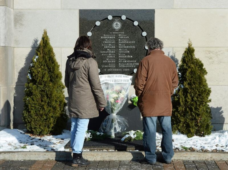 People look at the memorial plaque in honour of the 13 students and one staff member killed for the 27th anniversary of the Polytechnique Massacre in Montreal on Tuesday Dec. 6, 2016. (Ryan Remiorz / THE CANADIAN PRESS)