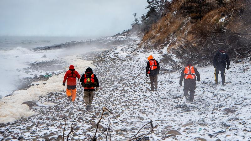 Members of a ground search and rescue team walk along the shore of the Bay of Fundy in Hillsburn, N.S. on Dec. 16, 2020, as they continue to look for five fishermen missing after the scallop dragger Chief William Saulis sank in the Bay of Fundy. (THE CANADIAN PRESS/Andrew Vaughan)