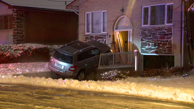 An alleged drunk driver crashed into the front door of a residence in Montreal North late Wednesday night after sliding through an intersection.