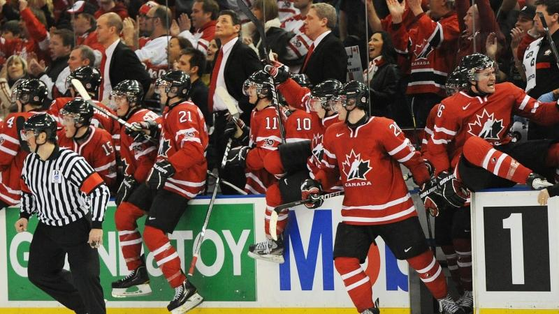 Team Canada celebrates their victory over Team USA during the IIHF World Junior Championships in Edmonton, Alta., on Saturday, Dec. 31, 2011. THE CANADIAN PRESS/John Ulan
