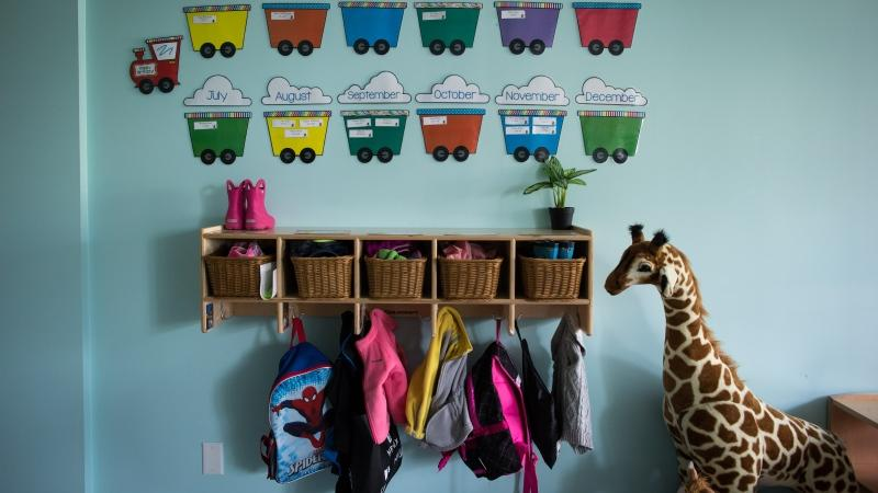 Children's backpacks and shoes are seen at a daycare on Tuesday May 29, 2018. (THE CANADIAN PRESS/Darryl Dyck)