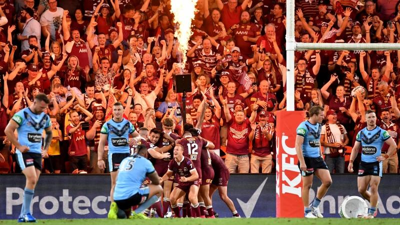 Queensland players celebrate winning the 2020 State of Origin series during Game 3 of the 2020 State of Origin series between the New South Wales Blues and the Queensland Maroons at Suncorp Stadium in Brisbane, Australia, Wednesday, Nov. 18, 2020. (Darren England/AAP Image via AP)
