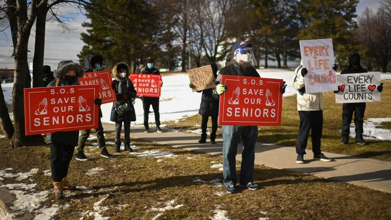 People protest outside the Tendercare Living Centre long-term-care facility during the COVID-19 pandemic in Scarborough, Ont., on Tuesday, December 29, 2020. This LTC home has been hit hard by the coronavirus during the second wave. THE CANADIAN PRESS/Nathan Denette