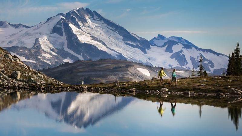 A couple is seen hiking along a mountain in Whistler, B.C. The New York Times named Canada one of the best places to travel in 2017, and the country earned international headlines for other global rankings.