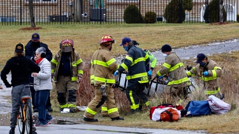 Windsor fire and Essex Windsor EMS rescue man after he fell into a pond in Windsor, Ont. on Saturday, Jan. 2, 2020. (OnLocation/CTV Windsor)