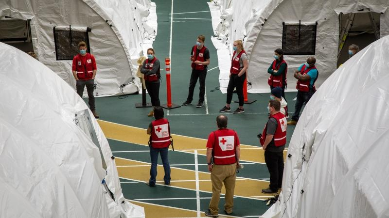 In this undated photo, the Canadian Red Cross works to set up a field hospital at the University of Alberta's Butterdome in Edmonton so that the facility could help care for a surge in COVID-19 patients by mid-January. (Credit: Canadian Red Cross)