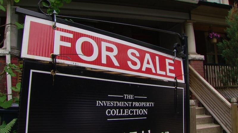 A real estate sign is pictured on a lawn. THE CANADIAN PRESS Jonathan Hayward