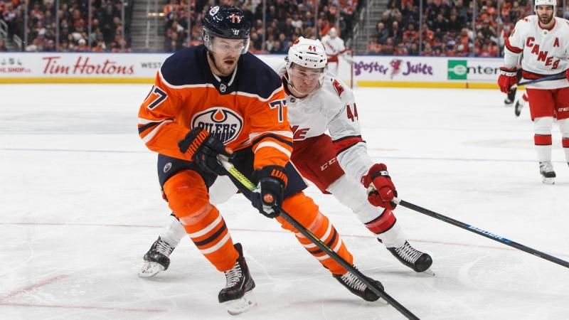 Carolina Hurricanes' Julien Gauthier chases Edmonton Oilers' Oscar Klefbom (77) during first period NHL action in Edmonton, Alta., on Tuesday December 10, 2019. THE CANADIAN PRESS/Jason Franson