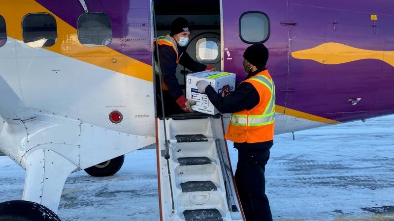 Chief pilot Lucas Charbonneau and pilot Gradyn Haapala load the Moderna vaccine to take to Southend & Wollaston. (Courtesy Colin Ratushniak)