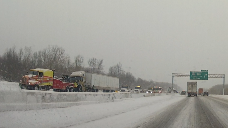 The westbound lanes of Highway 401 were closed near Highway 416 Wednesday morning as crews cleaned up a collision involving a transport truck. (Nate Vandermeer/CTV News Ottawa)