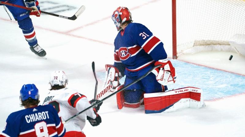 Ottawa Senators' Thomas Chabot scores past Montreal Canadiens goaltender Carey Price during first period NHL hockey action in Montreal on Thursday, February 4, 2021. THE CANADIAN PRESS/Paul Chiasson
