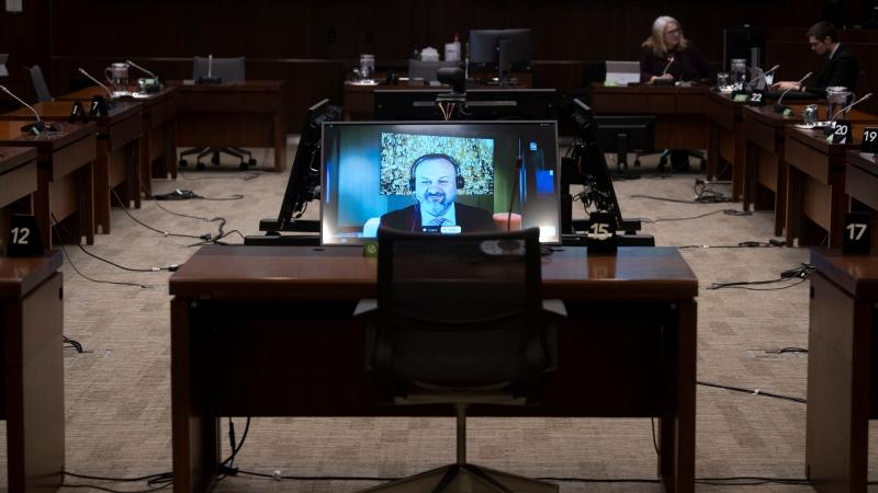 MindGeek Canada Managing Director Feras Antoon appears on a screen during a sound check as he waits to appear virtually before the House of Commons Standing Committee on Access to Information, Privacy and Ethics, Friday, February 5, 2021 in Ottawa. THE CANADIAN PRESS/Adrian Wyld