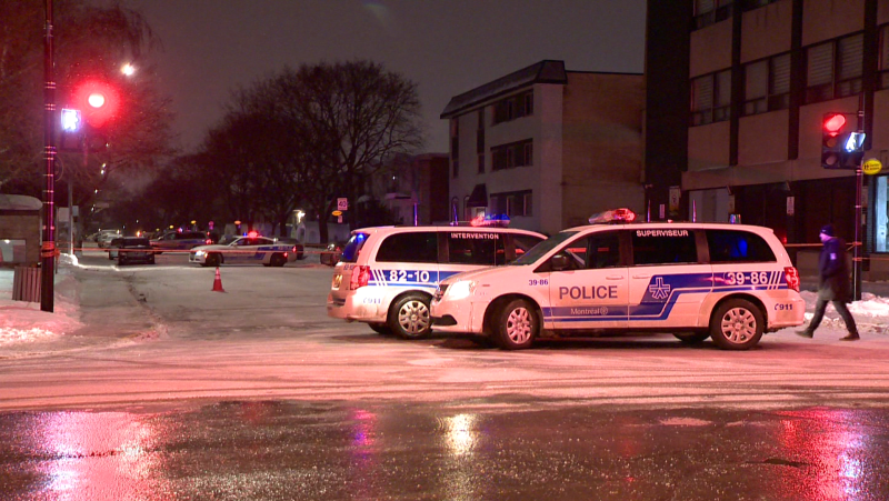 Montreal police vehicles on site of what has become the city's 5th homicide this year on Sunday, Feb. 8, 2021. (Cosmo Santamaria, CTV News)